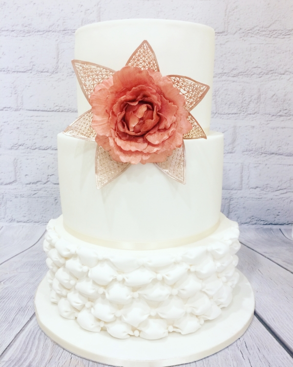 Three tier wedding cake with giant flower