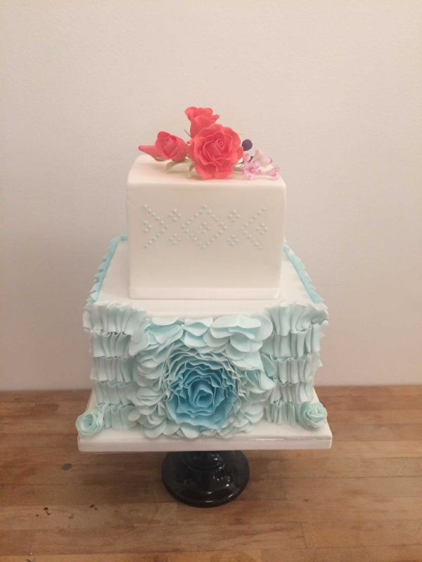 Blue ruffles with flowers wedding cake