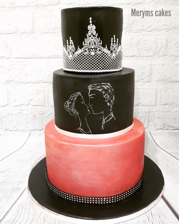 Three tier black and pink cake